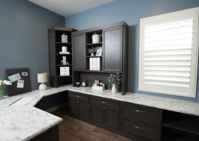 Dark Wood Home Office with Granite Countertops